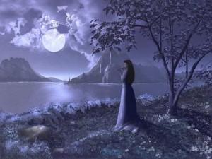 Mujer mirando a la luna